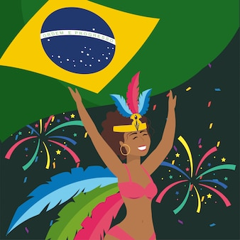 Bailarina linda chica con bandera de brasil y fuegos artificiales
