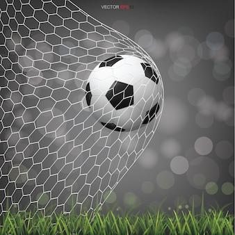 Balón de fútbol en campo de hierba verde con luz de fondo bokeh borrosa
