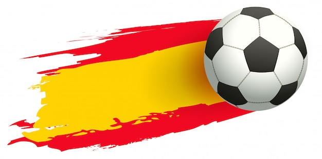 Balón de fútbol en el fondo de la bandera española