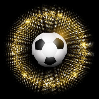 Balón de fútbol en el fondo de oro brillante