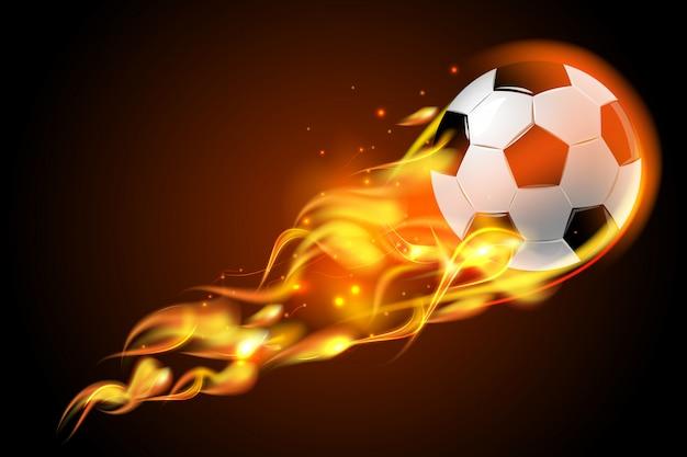 Balón de fútbol fuego sobre fondo negro
