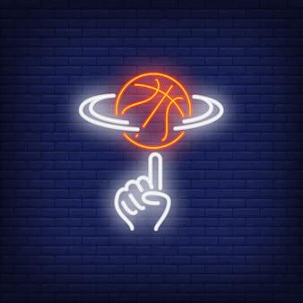 Baloncesto girando en señal de neón de dedo