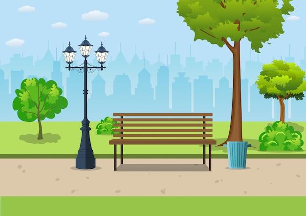 Banco con árbol y linterna en el parque.