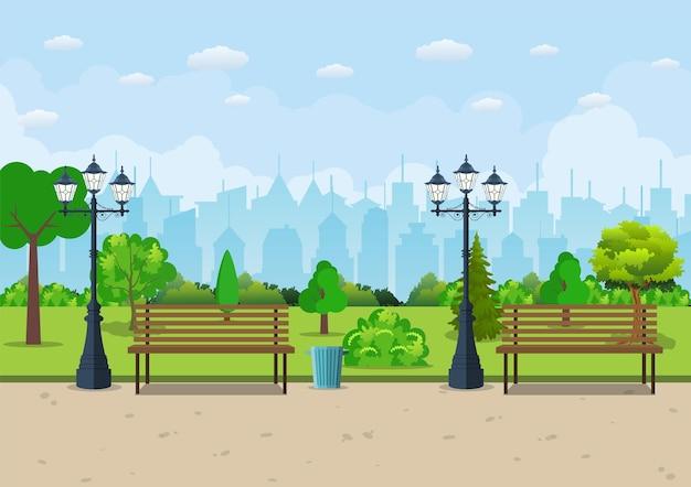 Banco con árbol y linterna en el parque