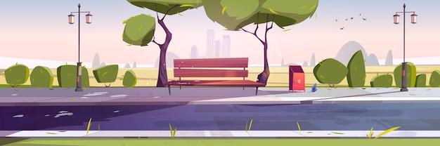 Banco en el paisaje del parque con vistas a la ciudad durante el día.