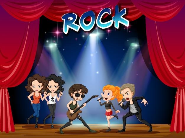 Banda de rock tocando en el escenario