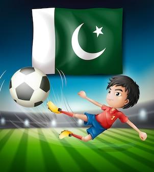 Bandera de pakistán y jugador de fútbol