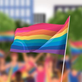 Bandera del día del orgullo en el fondo borroso