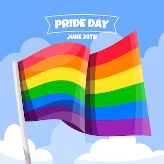 Bandera del día del orgullo en el fondo de nubes