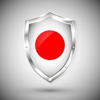 Bandera de japón en escudo de metal brillante. colección de banderas en escudo contra el fondo blanco. objeto aislado abstracto.