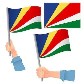 Bandera de seychelles en mano
