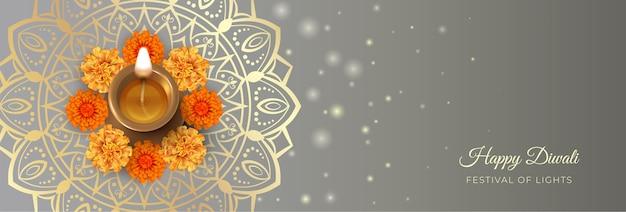 Bandera tradicional del festival de diwali con lámpara de aceite de diwali, flores de caléndula y adornos de mandala
