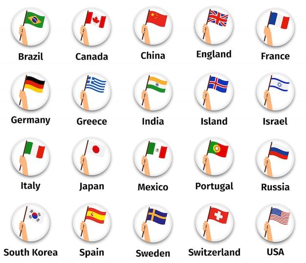 Banderas del mundo colocadas en la mano.