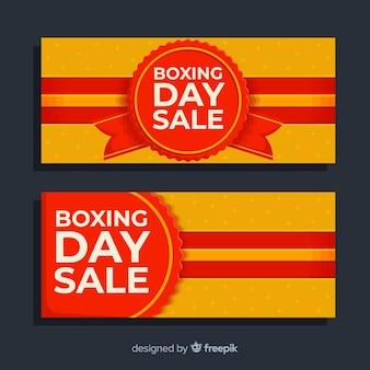 Banderas planas de venta del día del boxeo con etiquetas y cintas