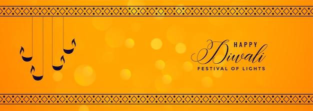 Banner amarillo deepawali con diya decorativo y borde de patrón