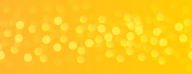 Banner amarillo con efecto de luz bokeh