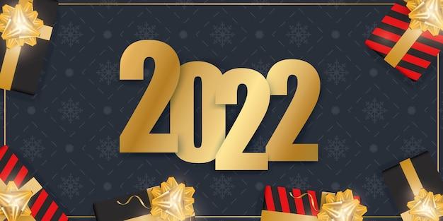 Banner de año nuevo azul oscuro. fondo con cajas de regalo realistas, cintas doradas y lazo.
