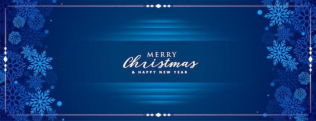 Banner azul feliz navidad con decoración de copos de nieve