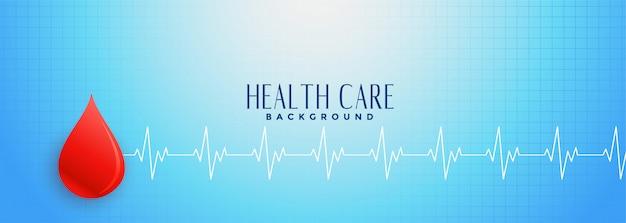 Banner azul de salud con gota de sangre roja