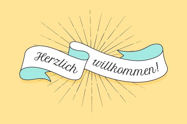 Banner de cinta de la vieja escuela con texto herzlich wllkommen en alemán