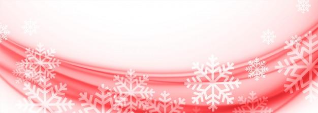Banner de copos de nieve de feliz navidad blanco y rojo