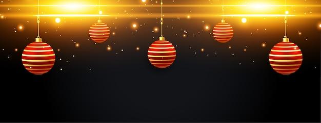 Banner de destellos de feliz navidad con bolas rojas doradas