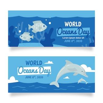 Banner de día de océanos dibujados a mano de delfines y peces