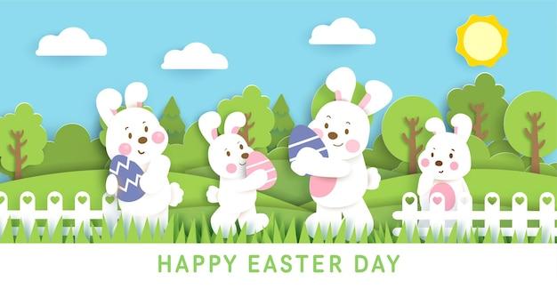 Banner del día de pascua con lindos conejos y huevos de pascua