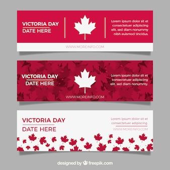 Banner del día de la reina victoria con hojas rojas y blancas