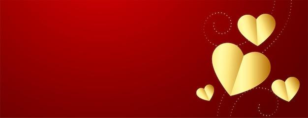 Banner del día de san valentín con corazones dorados y espacio de texto