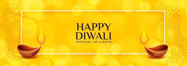 Banner de diwali amarillo con dos diya