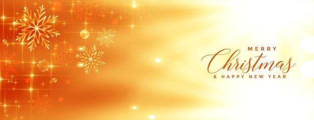 Banner dorado brillante feliz navidad copos de nieve