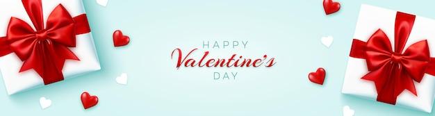 Banner de feliz día de san valentín con cajas de regalo