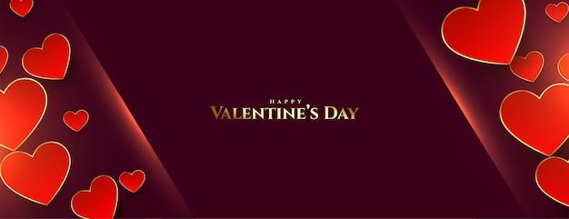 Banner de feliz día de san valentín con corazones dorados
