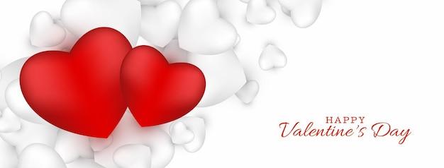 Banner de feliz día de san valentín dos corazones rojos