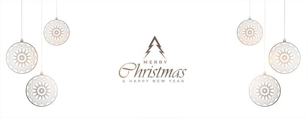 Banner de feliz navidad blanco con decoración de adornos