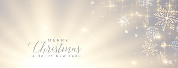 Banner de feliz navidad brillante con copos de nieve brillantes