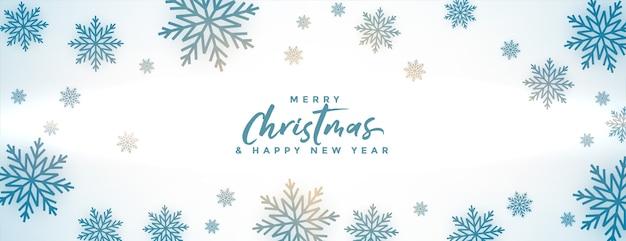 Banner de feliz navidad con copos de nieve de invierno