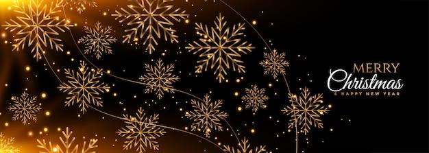 Banner de feliz navidad copos de nieve negro y oro