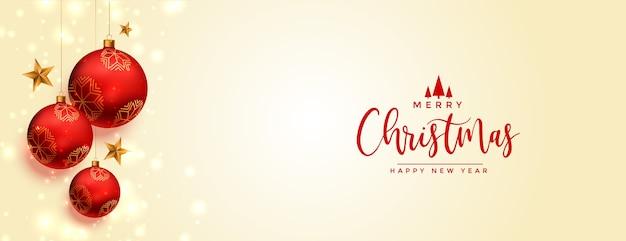 Banner de feliz navidad con decoración realista de bolas