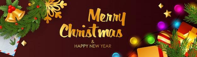 Banner de feliz navidad y feliz año nuevo con cascabeles