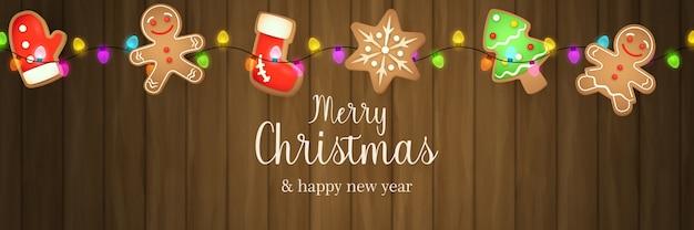 Banner de feliz navidad con pan de jengibre sobre suelo de madera marrón