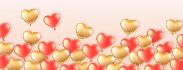 Banner horizontal en forma de corazón con globos dorados y rosas.
