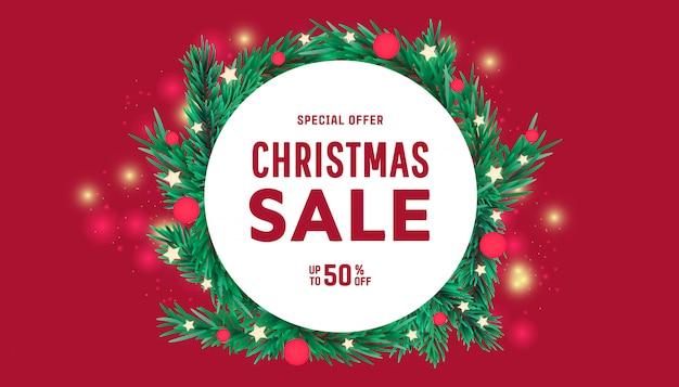 Banner de marco de venta de año nuevo o navidad con elementos decorativos de ramas de árbol.
