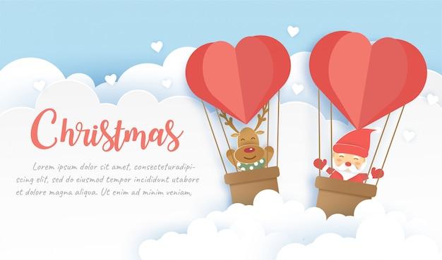 Banner de navidad con santa claus y renos en papel cortado y estilo artesanal.