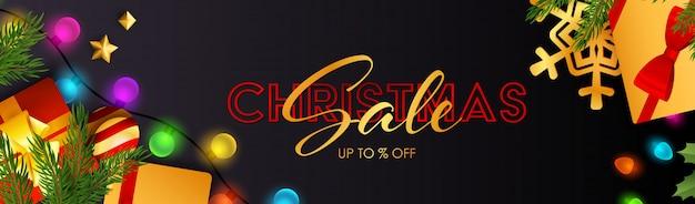 Banner de navidad venta con bombillas y regalos