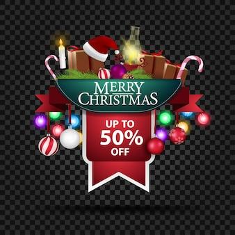 Banner navideño con 50% de descuento en regalos y lámpara antigua.