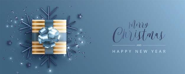 Banner navideño realista en azul y dorado.