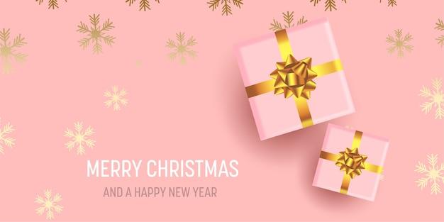 Banner navideño con regalos de lujo en diseño de copo de nieve