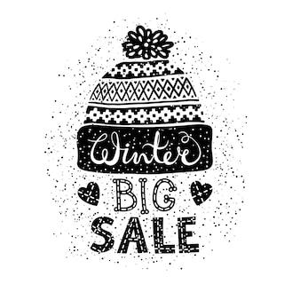 Banner o etiqueta especial de invierno con una gorra de lana tejida